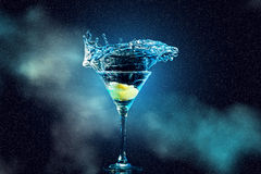 Cocktail in glass with splashes Royalty Free Stock Images