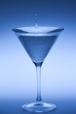 Cocktail glass with suspended droplet Royalty Free Stock Photography