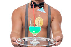 A cocktail glass on a tray in the hands of of the waiter Royalty Free Stock Photography