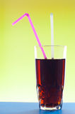 Cocktail glass with two jackstraws. On colorful background Royalty Free Stock Photos