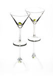 Cocktail Glasses. Two cocktail glasses sitting on a reflective surface Stock Photography