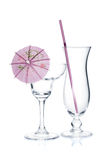 Cocktail glasses with drinking straw and umbrella Royalty Free Stock Photo
