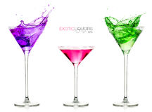 Cocktail glasses full of colorful drinks. Set of exotic liquors with Sample Text stock photo