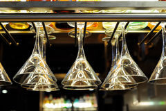 Cocktail glasses hanging above the bar royalty free stock photography