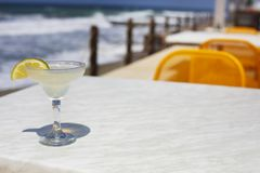 Cocktail glasses on sea background Royalty Free Stock Image
