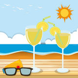 Cocktail glasses by the sea Stock Images