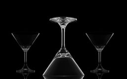 Cocktail glasses upside down on black Royalty Free Stock Photos
