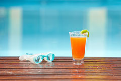 Cocktail and goggles at swimming Royalty Free Stock Photo
