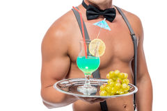 Cocktail and grapes on a tray of the waiter Stock Images
