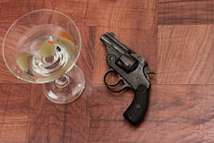 Cocktail and gun Stock Image