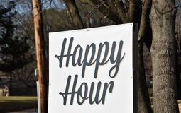 Cocktail Happy Hour at a Restaurant Bar. Happy hour is a marketing term for a period of time in which a venue such as a restaurant, bar, bowling alley, stadium royalty free stock photos