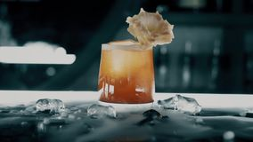 Cocktail with ice on the bar.  stock footage