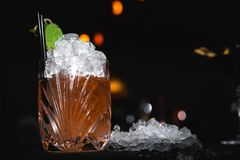 Cocktail with ice crash. Over black stock image
