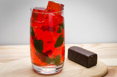 Cocktail with ice and leaves of mint. And glazed cheese curd Stock Photography