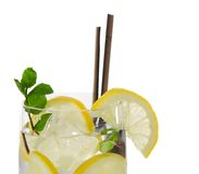 Cocktail with ice and lemon slice Stock Images