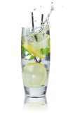 Cocktail with ice and lemon slice. On white background Stock Photography