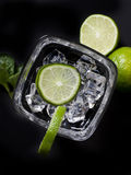 Cocktail with ice and lime Stock Images