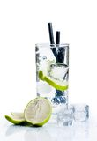 Cocktail with ice and lime slice isolated Royalty Free Stock Photography