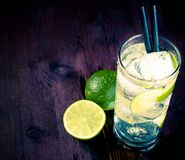 Cocktail with ice and lime slice and space for text, club atmosphere Royalty Free Stock Photography