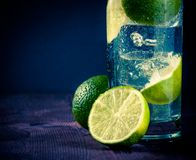 Cocktail with ice and lime slice and space for text, club atmosphere Stock Image
