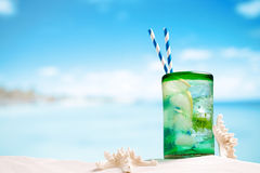 Cocktail with ice, rum, lemon and mint   in a  glass  on beach Stock Photography
