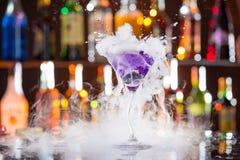 Cocktail with ice vapor on bar desk royalty free stock photos
