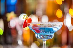Cocktail with ice vapor on bar desk stock photography