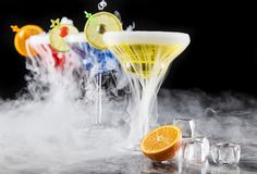 Cocktail with ice vapor on bar desk Royalty Free Stock Photos