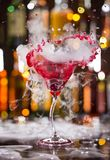 Cocktail with ice vapor and splashing liquid Royalty Free Stock Photography