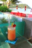 Cocktail by the infinity swimming pool Stock Photography