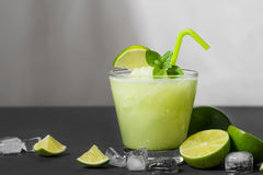 Cocktail juice with lime, mint and ice. Bar drink accessories on Stock Photos