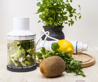 Cocktail of kiwi and lemon juice and parsley. Stock Images