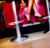 Cocktail and legs. Night club cocktail and legs scene stock photography