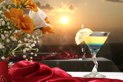 Cocktail with lemon. Beautiful flower arrangement and  glasses decorating  restaurant christmas table Stock Images