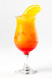 Cocktail with lemon and cherry. Yellow and red cocktail with ice and lemon Stock Photos