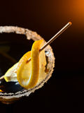 Cocktail with lemon. Focus on a foreground Royalty Free Stock Image