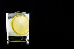 Cocktail with lemon and ice Stock Photos