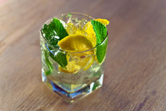 Cocktail with lemon and peppermint leaves Stock Photo
