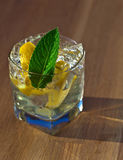 Cocktail with lemon and peppermint leaves Royalty Free Stock Photography