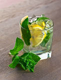 Cocktail with lemon and peppermint leaves Stock Images