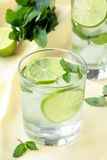 Cocktail lemonade. Lemonade cocktail with lime and mint ice Royalty Free Stock Image