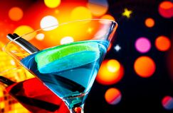 Cocktail with light disco bokeh background with space for text Royalty Free Stock Photo