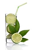 Cocktail with lime. And straw in longdrink glass stock photography