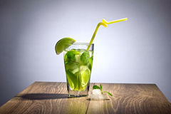 Cocktail with lime Stock Images