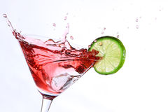Cocktail with lime. Red cocktail with lime on white Royalty Free Stock Image