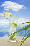 Cocktail lime on beach Royalty Free Stock Image