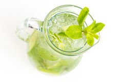 Cocktail with lime. Clear cocktail with ice and lime Royalty Free Stock Image