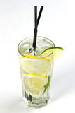 Cocktail with lime. Clear cocktail with ice and lime Royalty Free Stock Photo