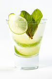 Cocktail with lime. Clear cocktail with ice and lime Stock Photography