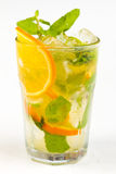 Cocktail with lime. Clear cocktail with ice, lime and orange Royalty Free Stock Image